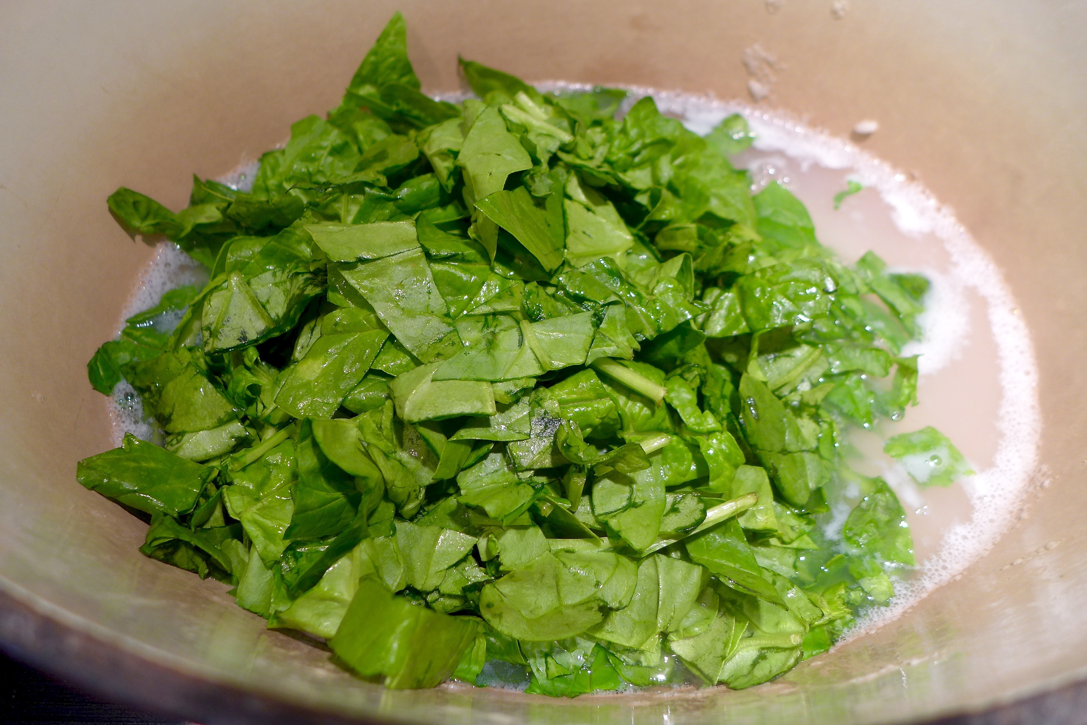 Add spinach to rice, cover and let wilt.