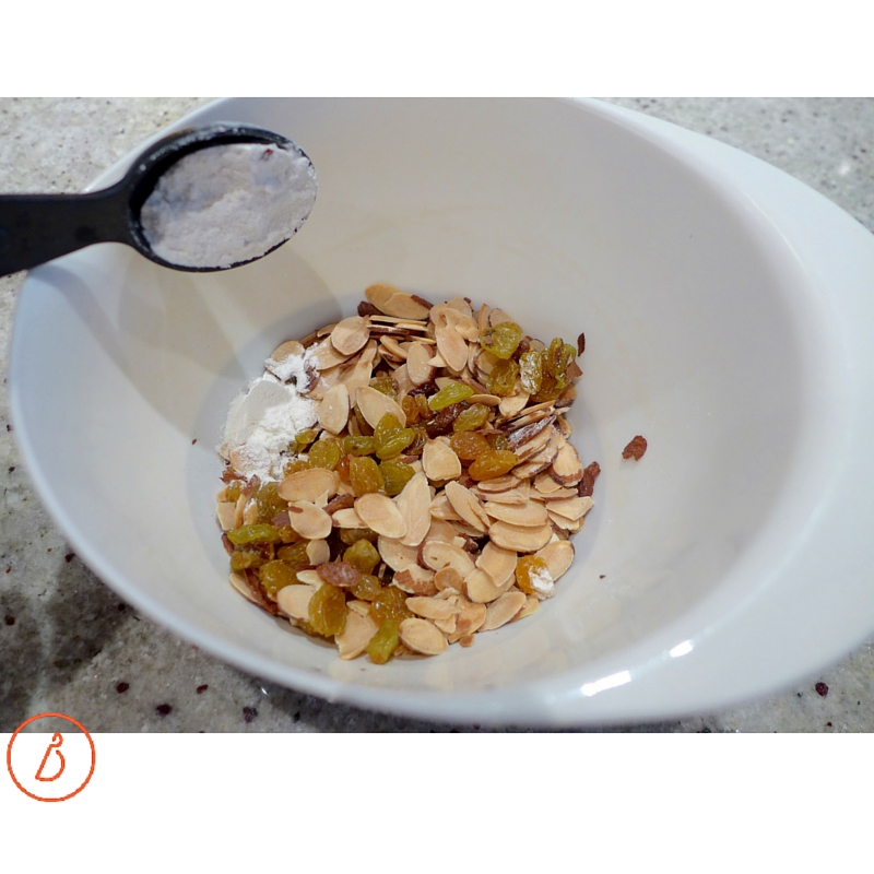 Add a tablespoon of flour to mix-ins like almonds and raisins to keep them from falling to the bottom of the cake. This works for other baked goods, like blueberry muffins or zucchini bread.